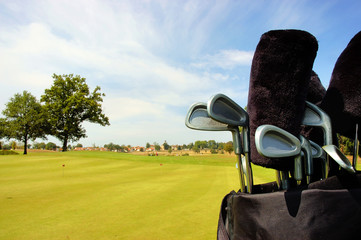 close up from golf bag with clubs