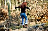 woman balancing on the stump poster