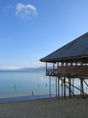 lake with clear water and a house with pile, poso lake, sulawesi