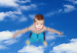 the boy flies in clouds