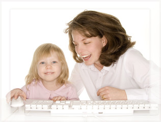 daughter showing mom something on computer laughin