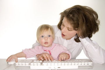 mother teaching toddler computer