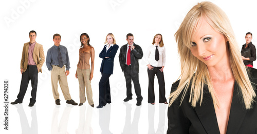 blonde businesswoman standing in front of a busine