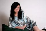 chinese woman recumbant on pillows poster