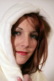 redhead woman in white hood poster