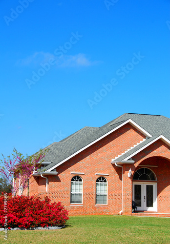 brick home with landscaping