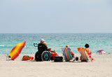 disabled traveler on the beach poster