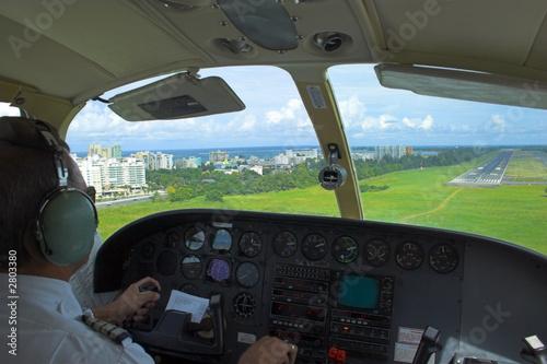 Leinwandbild Motiv pilot is getting ready for landing