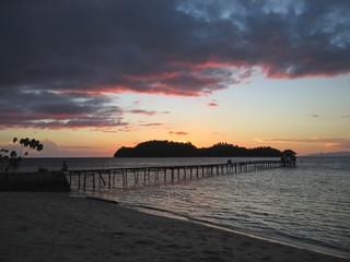 sunset over a tropical beach, togian island, sulawesi, indonesia