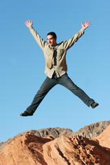 ecstatic businessman jumping