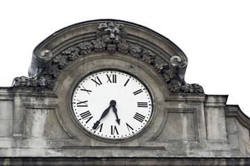 horloge ancienne sculptée sur les toits à lyon