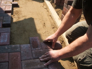 brick paver working