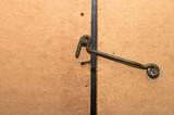 rusty hook from a wire poster