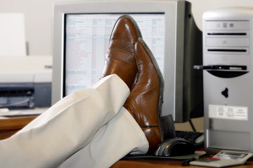 feet propped up on a desk