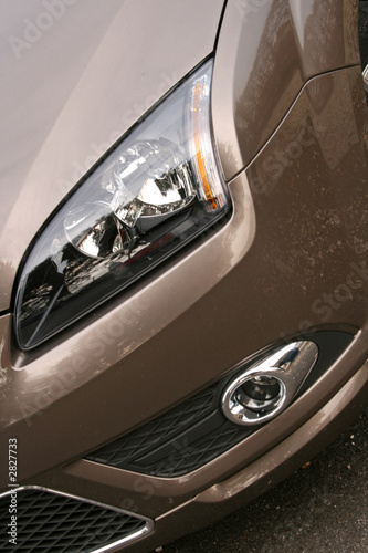 gold car headlight