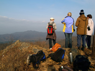 group of hiking people on the mountain top