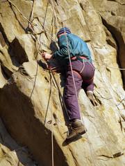 climber on mountain wall