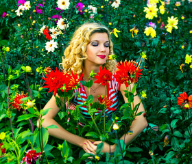beautiful girl hugging dahlia flowers