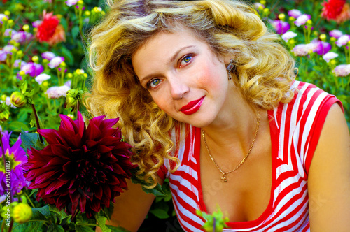 beautiful girl among dahlia flowers