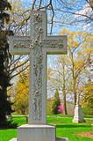 memorial cross grave marker at historic spring grove cemetery in poster
