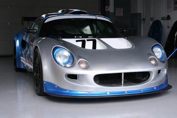 silver racing car in garage
