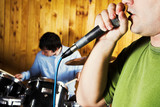 drummer and rock singer poster
