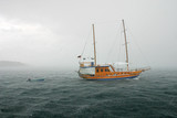 passenger yacht in the stormy ocean poster