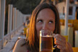 Leinwandbild Motiv woman drinking beer