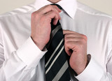 business man adjusting tie poster
