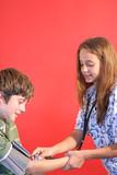 nurse student checking blood pressure vertical poster