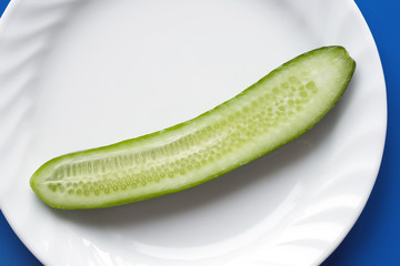 cucumber on white plate