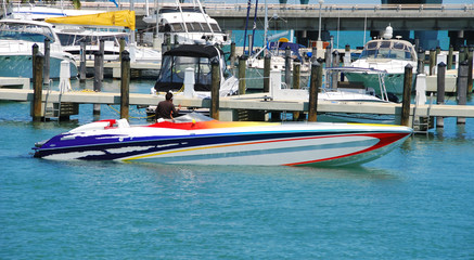 multi-colored speedboat  at dock
