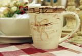 pottery mug on a table poster