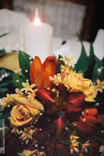 yellow, orange & red rose bouquet by candle