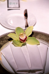 table setting with orchid