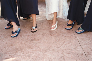 bride and bridemaids with flip flops