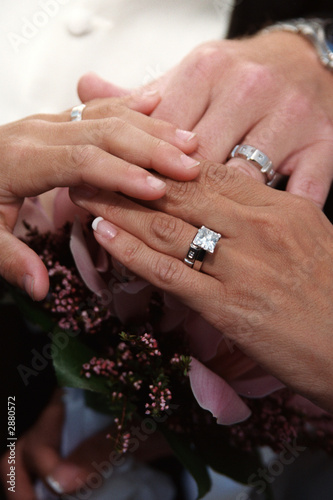 bouquet with bridal couple hands and child