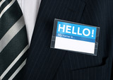 close-up of a welcoming name tag poster
