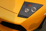 yellow supercar headlight