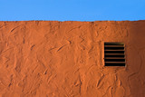 stucco wall and blue sky detail. texture backgroun poster