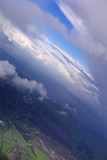 aerial of earth view with dramatic clouds and blue poster