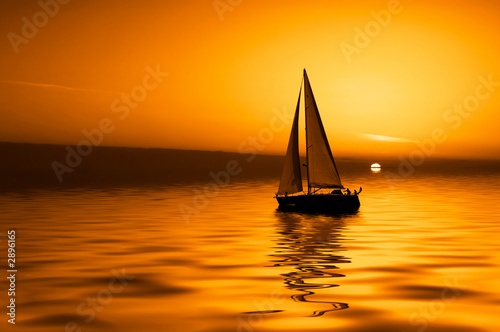 Leinwanddruck Bild sailing and sunset