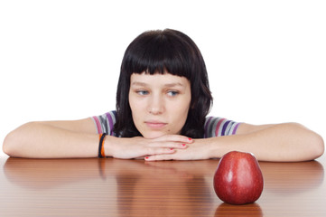 girl watching a red apple