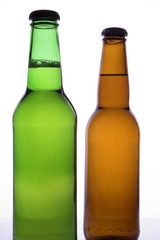 two beer bottles with no labels