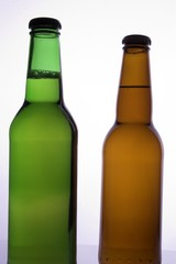 two beer bottles with no labals