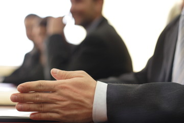 close-up of a hand in business meeting