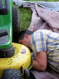 man repairing lawn mower poster