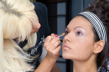 beautiful girl model, while make-up before shootin