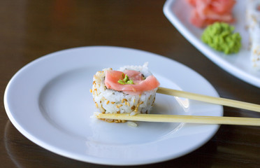 sushi roll between two sticks