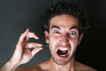 man pulling his beard with tweezer